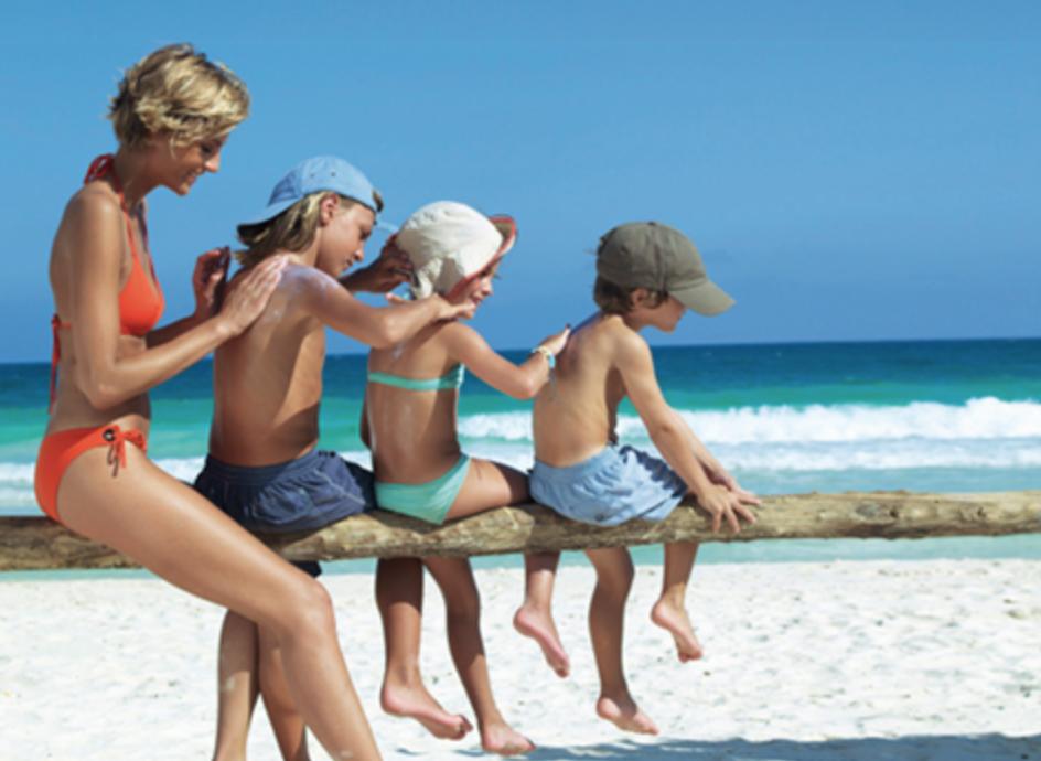 Sunscreen application on beach
